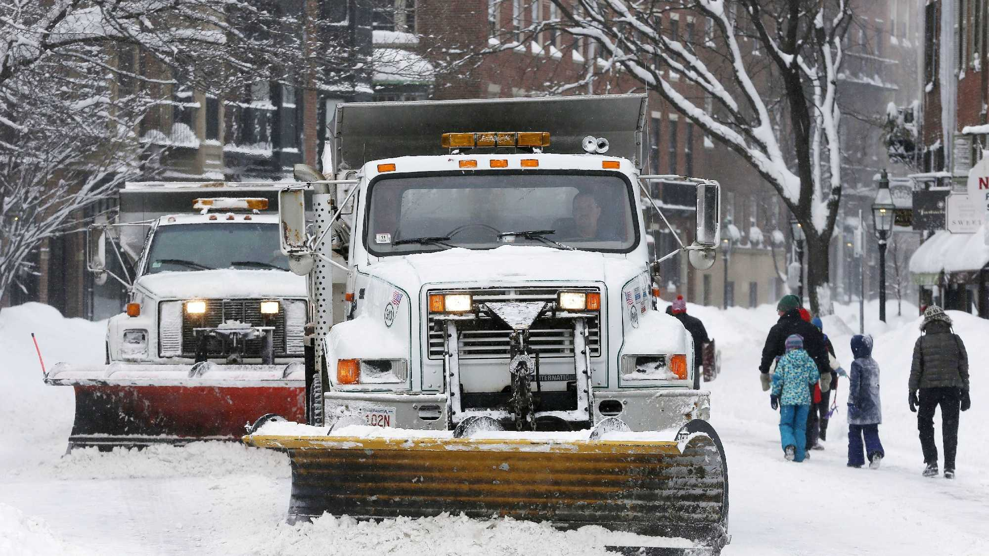 Plows clear Charles Street in Boston, Sunday, Feb. 15, 2015. A blizzard warning was in effect for coastal communities from Rhode Island to Maine, promising heavy snow and powerful winds to heap more misery on a region that has already seen more than 6 feet of snow in some areas.