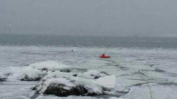 Rescuers wore an ice rescue suit to get to the duck.