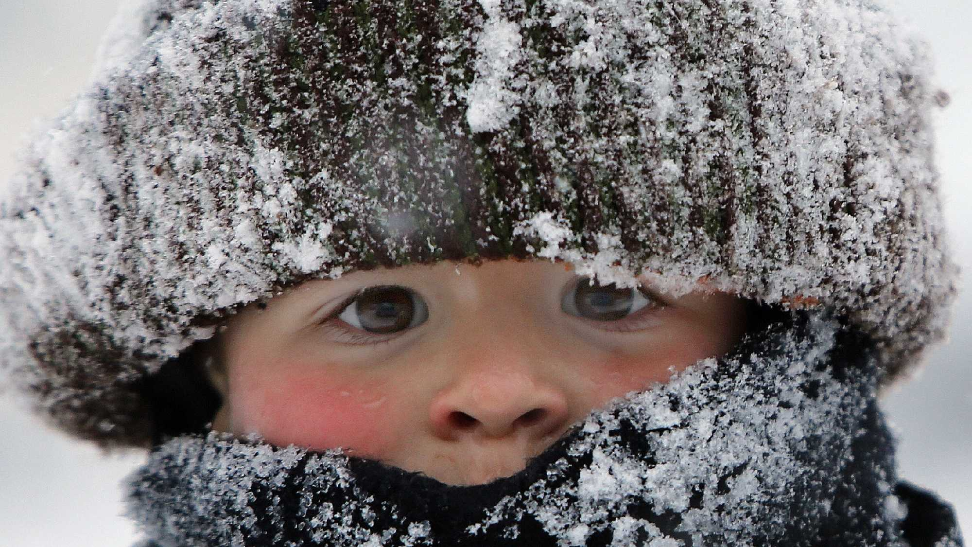 Will Annicchiarico is bundled up as he plays in the snow following a snowstorm Tuesday, Jan. 27, 2015, in Concord, N.H.