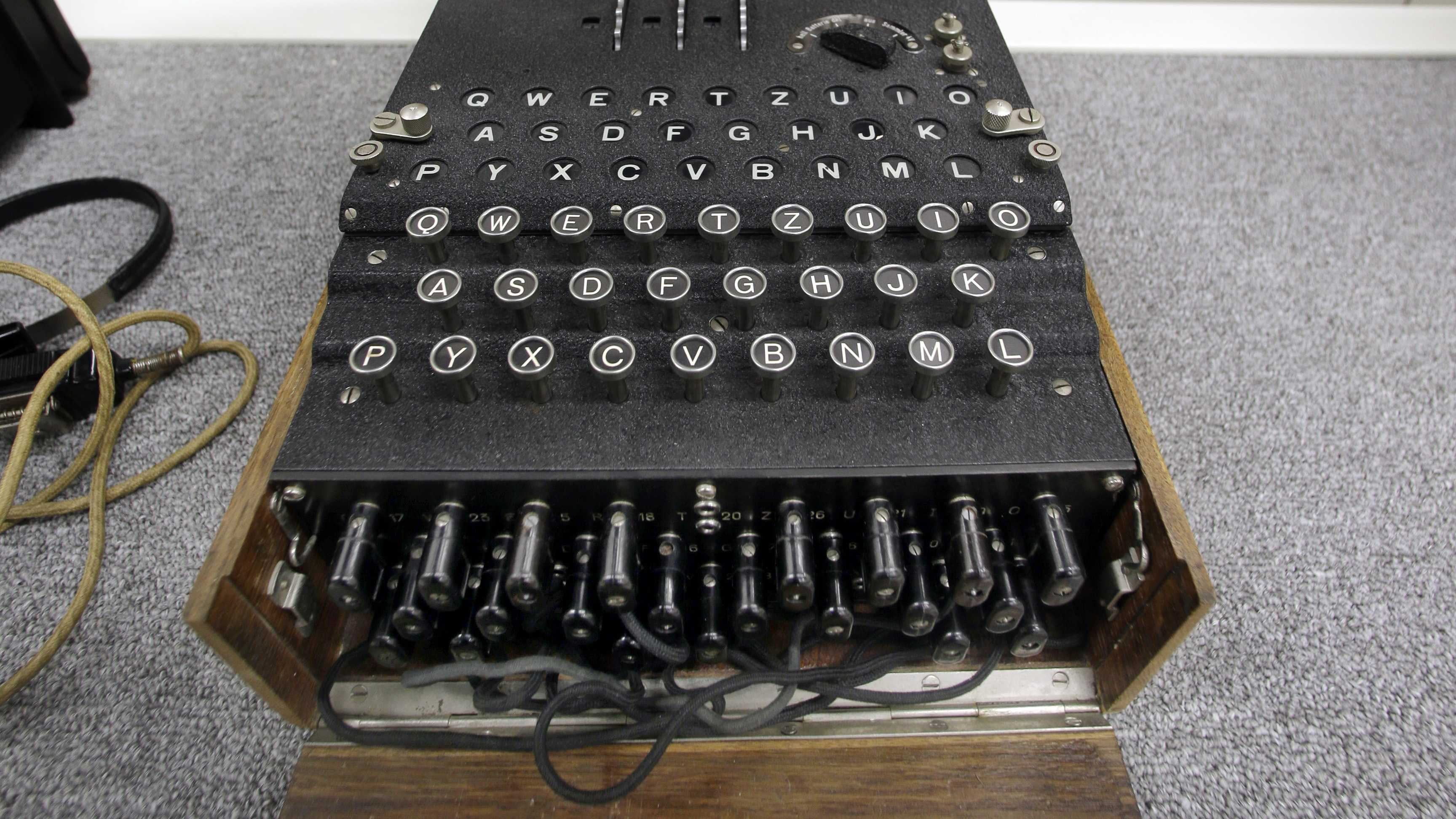 "A Nazi Enigma encryption machine is displayed at the World War II Museum in Natick, Mass., Wednesday, Feb. 18, 2015. In the Oscar-nominated film ""The Imitation Game,"" Benedict Cumberbatch leads a code-breaking operation targeting the Nazis' infamous Enigma encryption machines. The obscure suburban Boston museum boasts the largest U.S. collection of Enigmas outside of the NSA."
