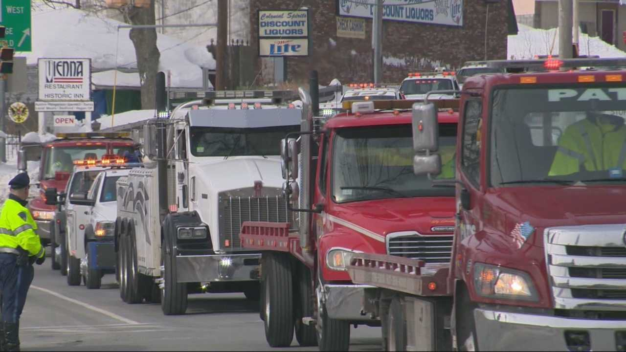 Tow truck drivers are honoring a fallen comrade with a funeral procession including dozens of tow trucks.