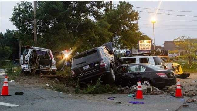 A Range Rover driven by Benjamin Shealey sits atop another vehicle after a July 2013 high-speed police chase that began in Harwich and ended near the Kream N' Kone restaurant on Route 28 in Chatham. A pedestrian was killed and members of the family in the Volvo SUV at left were injured.