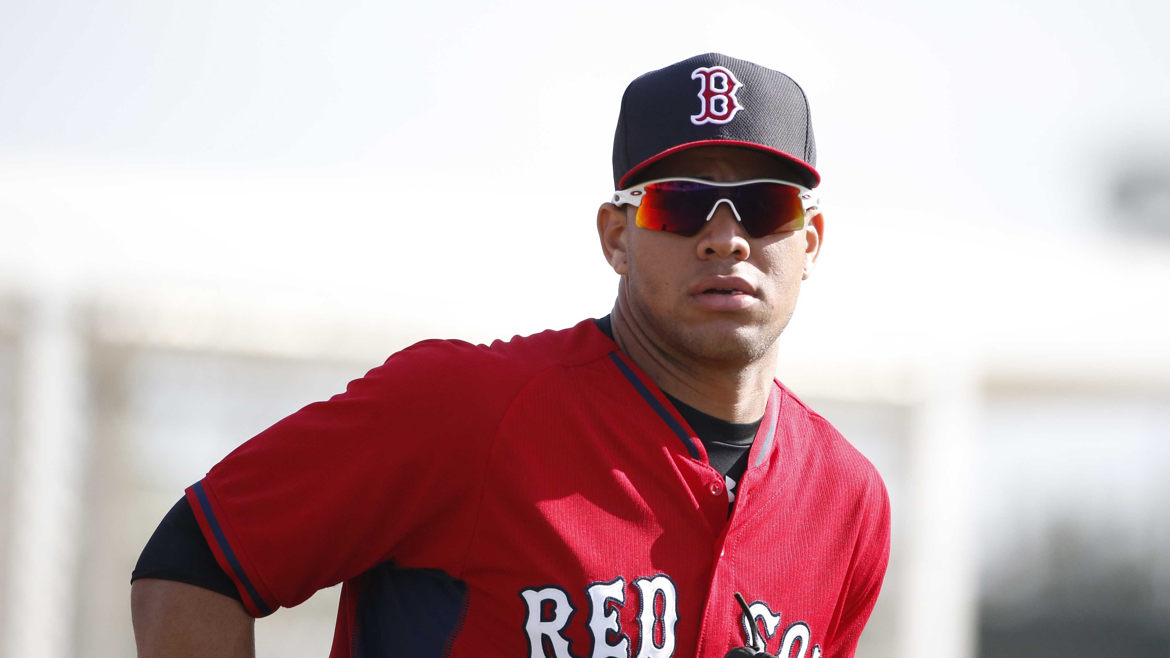 Boston Red Sox' Yoan Moncada practices during spring training, Friday, March 13, 2015, in Fort Myers Fla. The Red Sox have finalized a minor league contract with the 19-year-old Cuban infielder that includes a $31.5 million signing bonus, easily a record for an international amateur free agent under 23 years old.