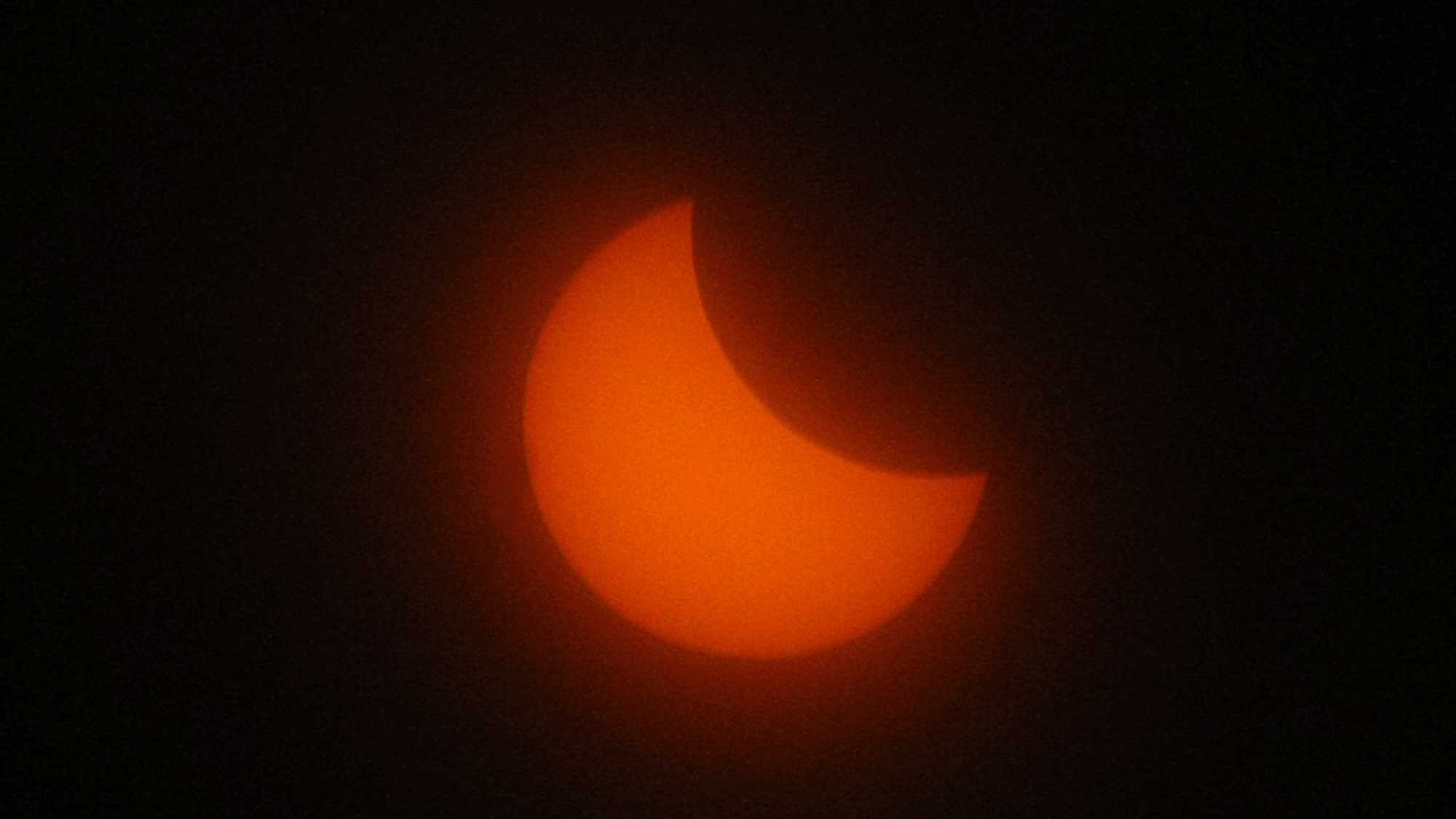 The sun is seen during a solar eclipse in Marseille, southern France, Friday, March 20, 2015. An eclipse is darkening parts of Europe on Friday in a rare solar event that won't be repeated for more than a decade.