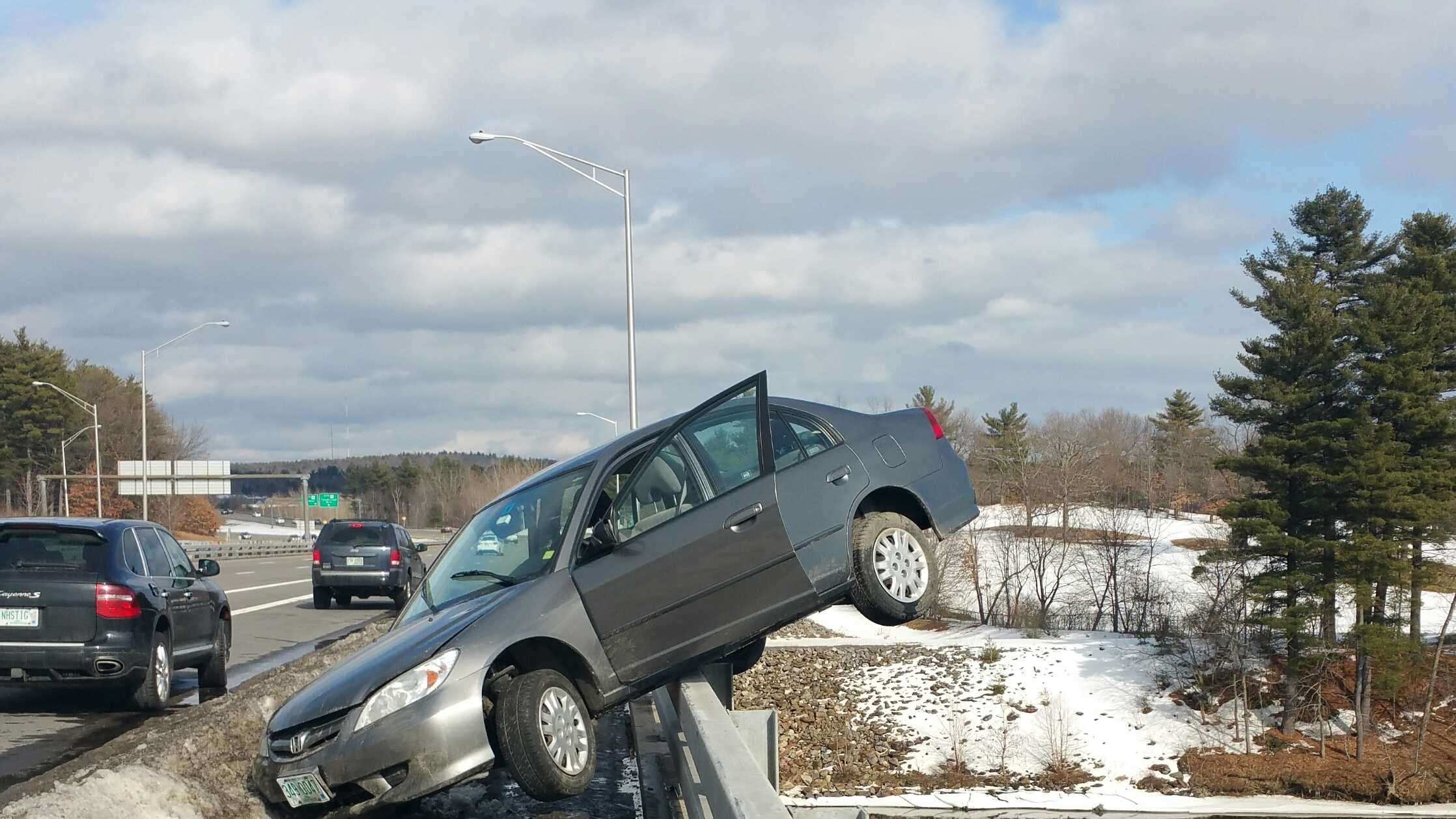 A Nashua teenager is unhurt after nearly driving his car off the Sagamore Bridge in Nashua, New Hampshire, Saturday.