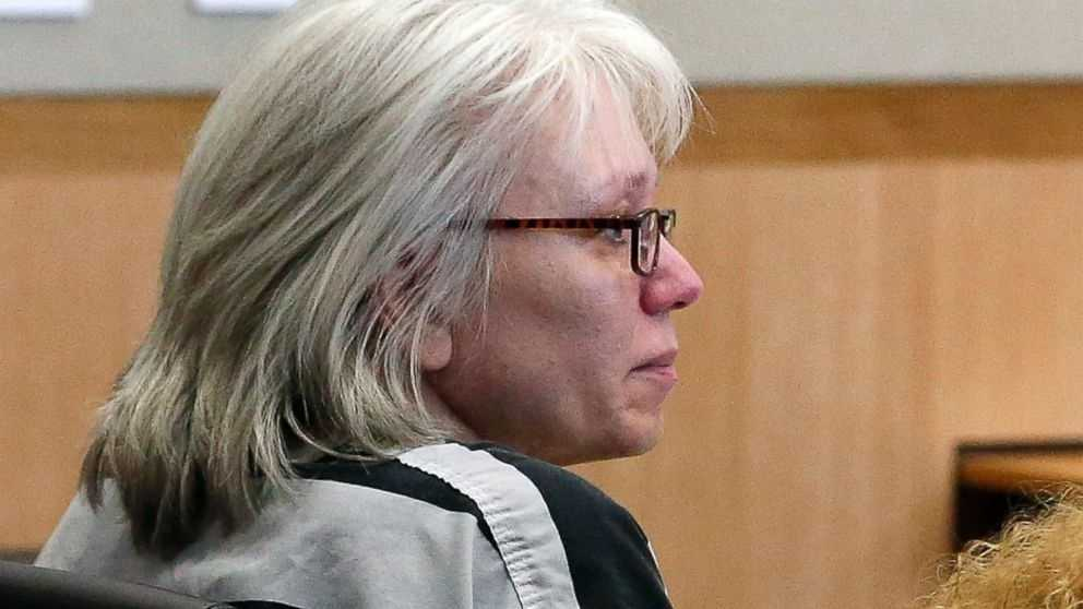 FILE - In this Aug. 1, 2013, file photo, Debra Jean Milke listens to a judge during a hearing at Maricopa County Superior Court in Phoenix. A judge on Monday, March 23, 2015, dismissed the murder case against Milke, who spent more than 20 years on death row in the 1989 killing of her 4-year-old son. Judge Rosa Mroz ended the case after prosecutors lost their last appeal last week.