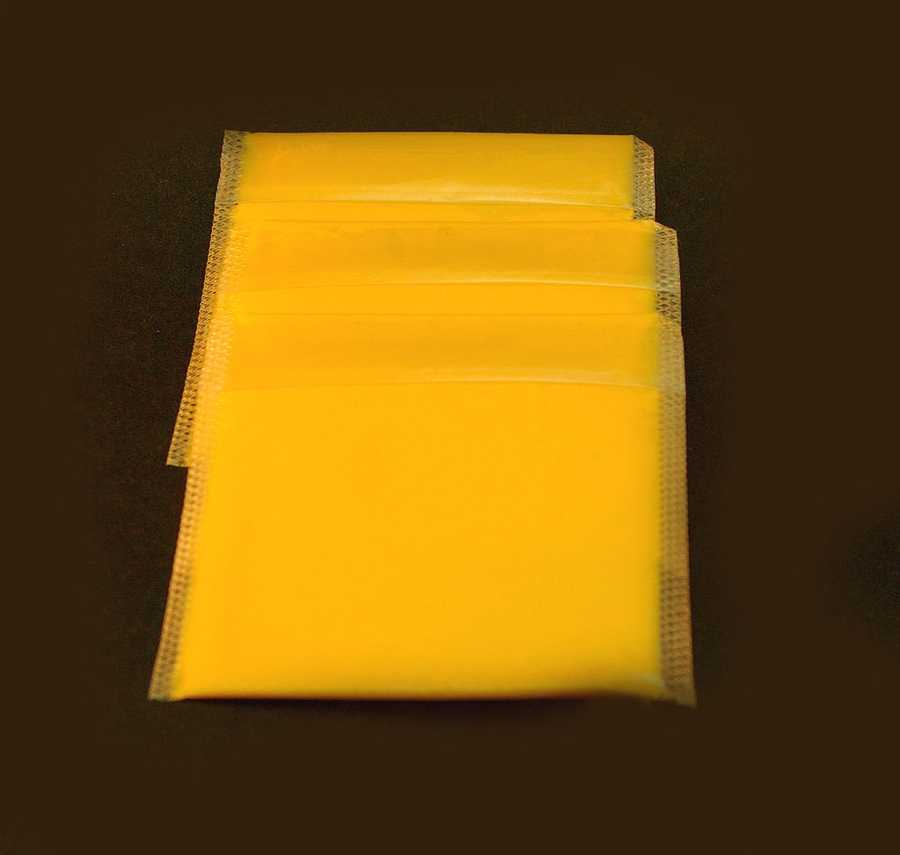 American cheese: Dietitians will argue that American cheese isn't cheese at all. While brands differ in content, most American cheese is high in sodium and so high in fat that one slice more closely resembles high-fat meat than diary.