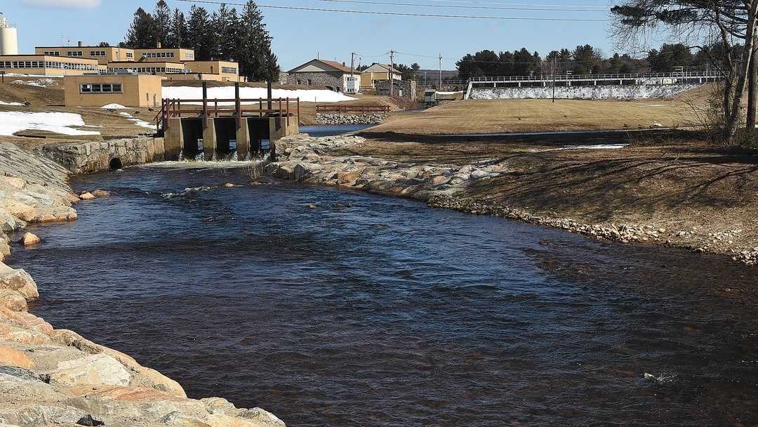Water flows Thursday where the Groton Utilities reservoir empties into the Poquonnock River.