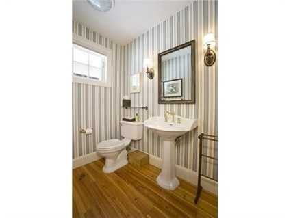 The home has four bathrooms and one partial bath.
