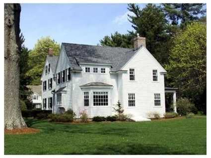 Handsomely sited on .65 acres, the property includes a carriage house with garaging for 3 cars and a gardener's room plus an expanded, paved driveway with plenty of guest parking.