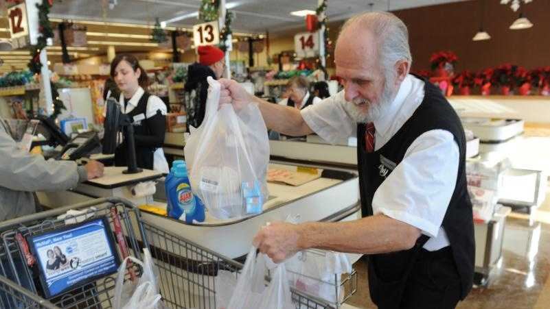 Michael Stone of Ashfield puts groceries in plastic bags into a cart at Big Y Supermarket in Greenfield.