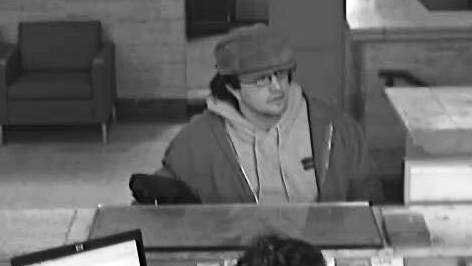A surveillance image of a robbery suspect at Santander Bank in Southbridge on Monday