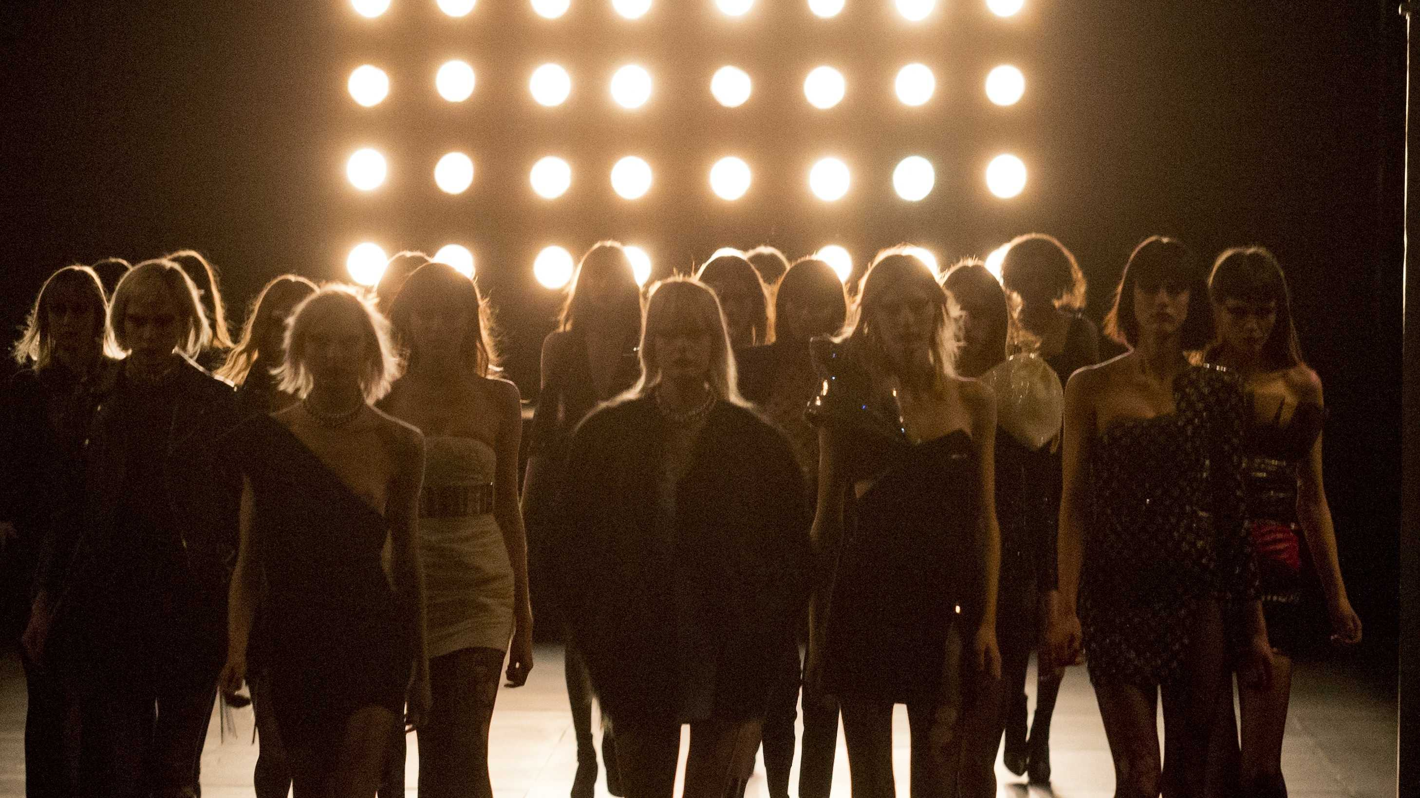 In this March 9, 2015 file photo, models wear creations for Saint Laurent's Fall/Winter 2015-2016 Ready to Wear fashion collection presented in Paris, as part of Paris Fashion Week.