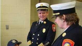 Helber Nunez, Jr., 6, with Hanover Fire Chief Jeffrey Blanchard and Deputy Chief Barbara Stone, was awarded a young hero award at Hanover Fire Headquarters, Saturday.