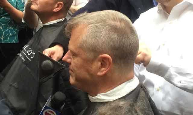 Gov. Charlie Baker sheared off most of his graying blond locks as part of a fundraising drive to support the Dana-Farber Cancer Institute on Tuesday.