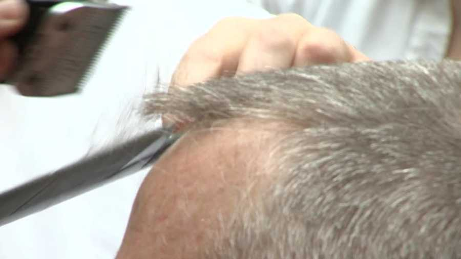 Baker joined more than 500 company employees who will also be shaving their heads.
