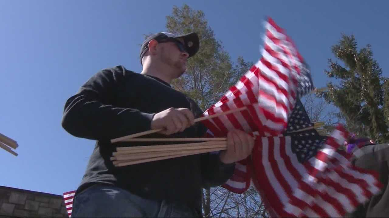 Veterans' groups in his hometown are handing out American flags to honor a 22-year-old Army medic killed in Afghanistan.