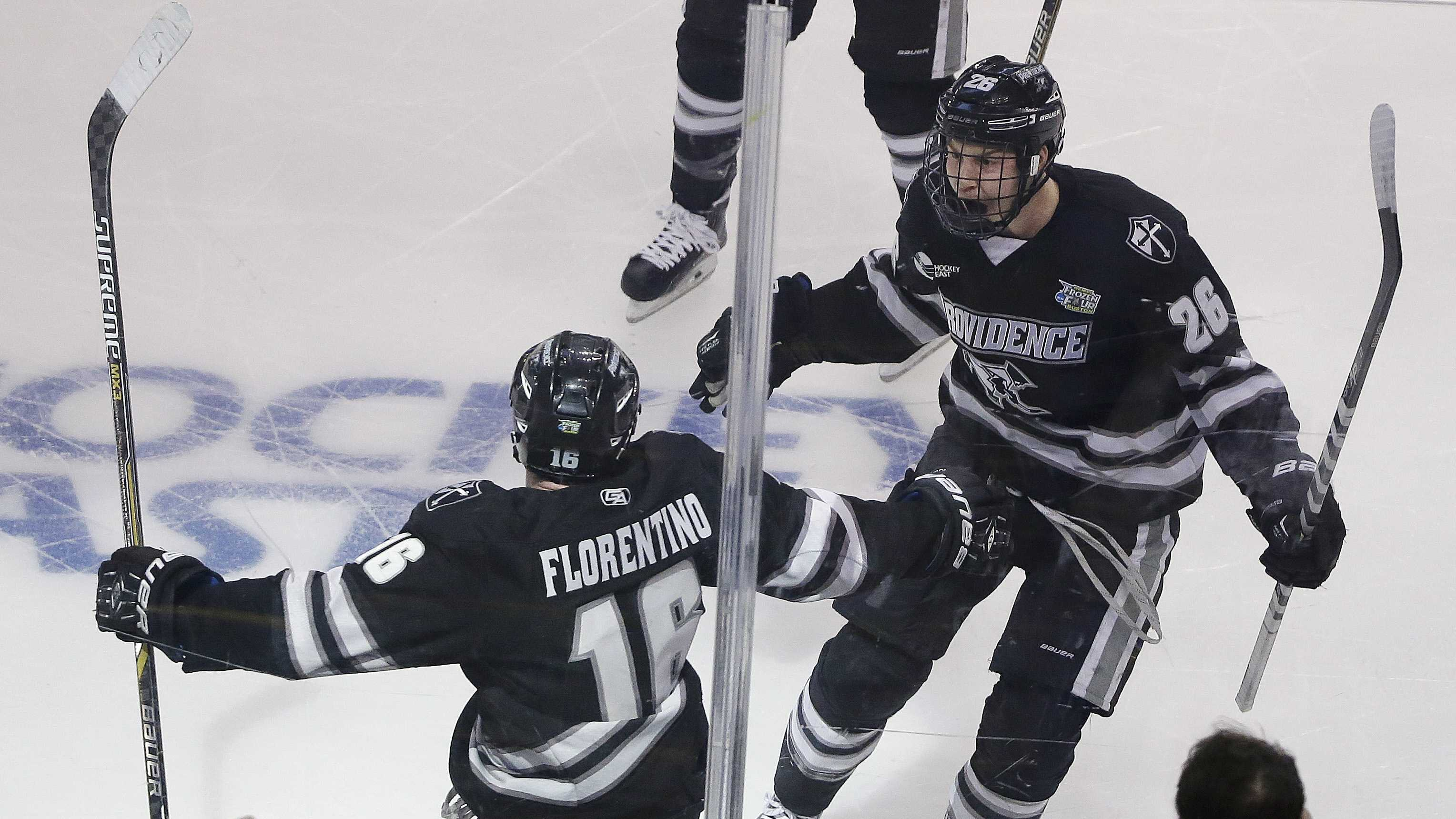 Providence defenseman Anthony Florentino (16) celebrates his goal against Boston University with teammate Brian Pinho (26) during the first period of the NCAA men's Frozen Four hockey championship game in Boston, Saturday, April 11, 2015.