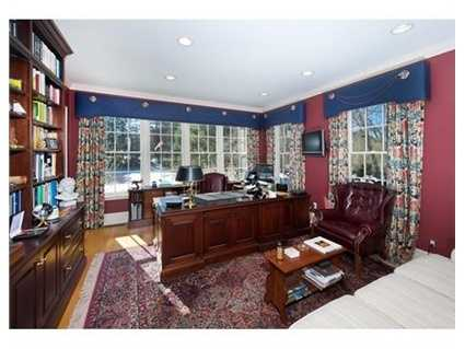 The richly paneled mahogany office and three season porch are among many of the rooms offering Charles River views.