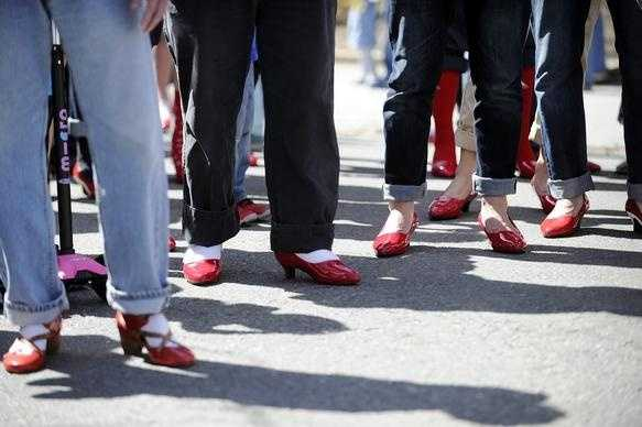 Men wear red, women's high-heeled shoes during Brookline's first annual Walk a Mile in Her Shoes, an international men's march to stop rape, sexual assault, and gender violence on Sunday, Apr. 12, 2015.