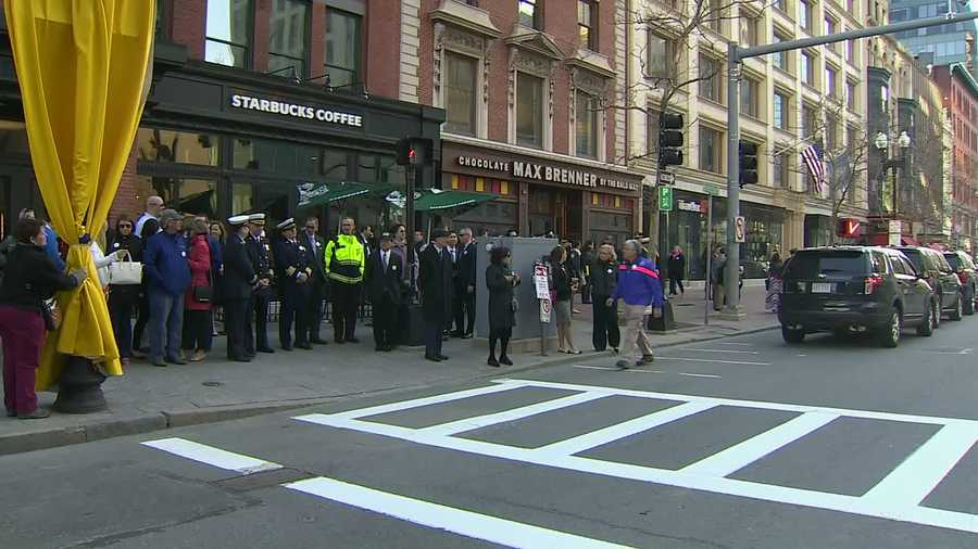Boston firefighters and others gather to mark the second anniversary of the Boston Marathon Bombing on Boylston Street.