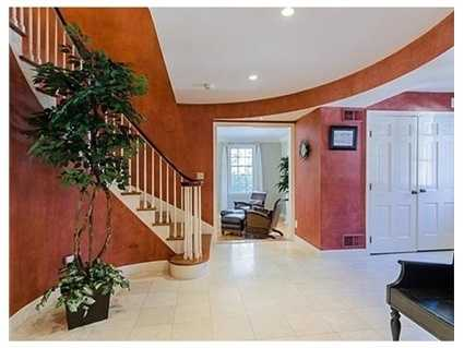 There's a gracious foyer with curved stairs.