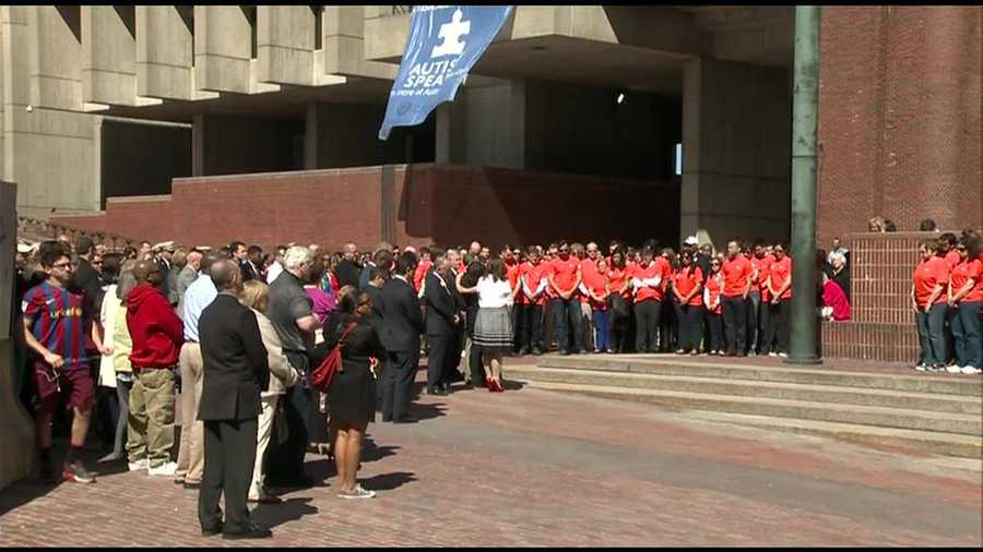 The Richard family join the moment of silence at City Hall Plaza.