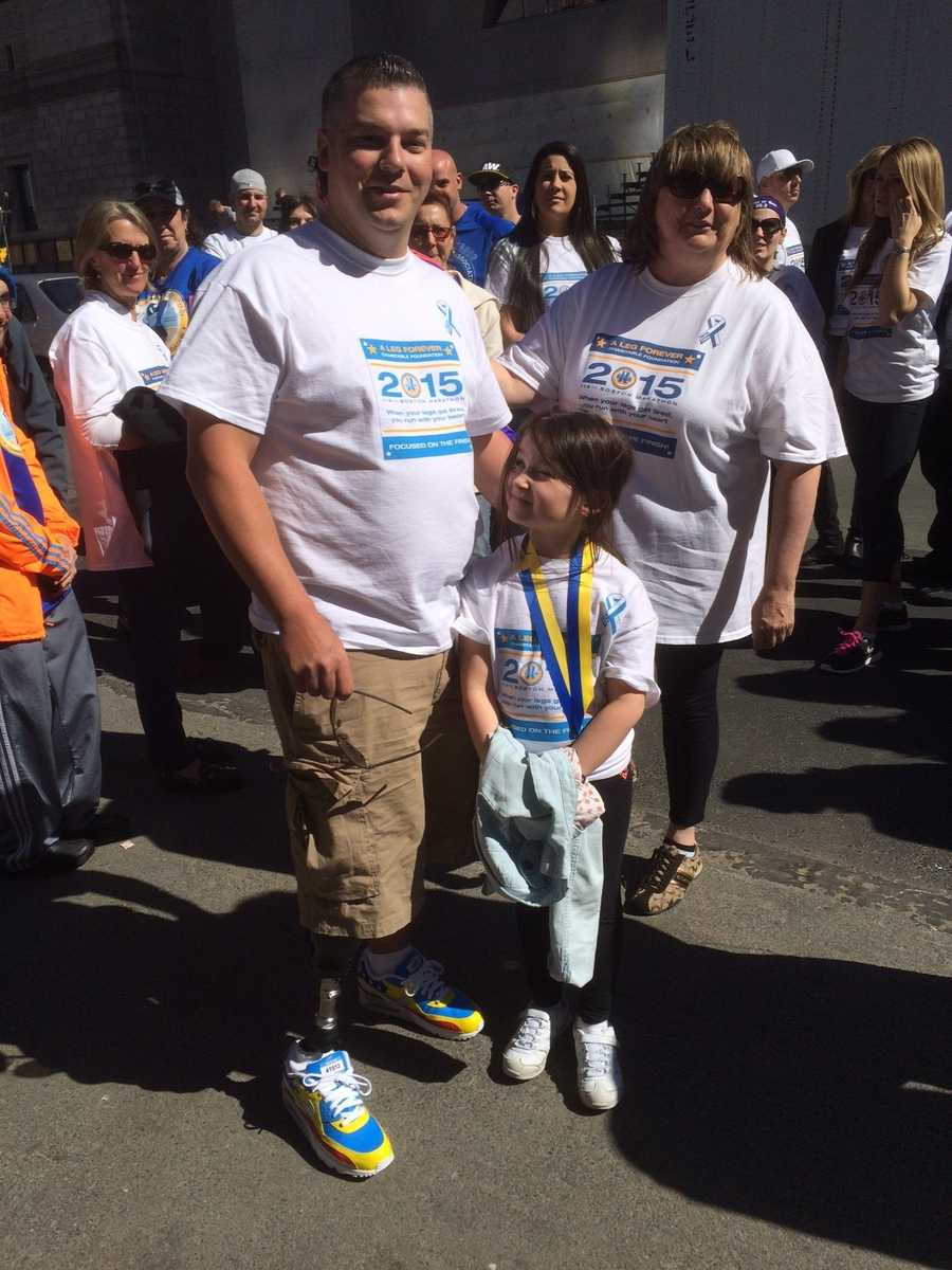 Bombing survivor JP Norden with his mother and niece at finish line.