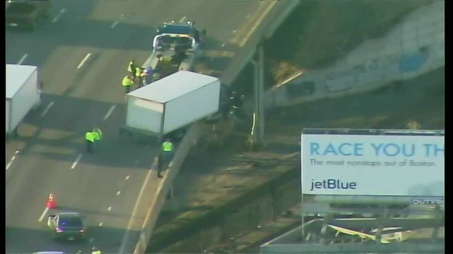 The right lane of Interstate 93 South was closed Thursday after a crash left a box truck hanging over the side of the roadway, according to state police.