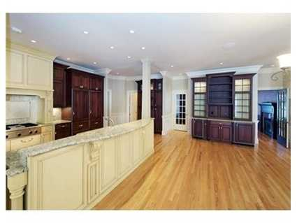 Gourmet kitchen with state of the art appliances, custom cabinets, granite counters & large center island.