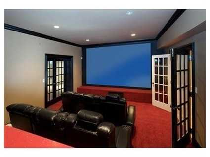 Finished lower level includes game room, home theater area & gym.