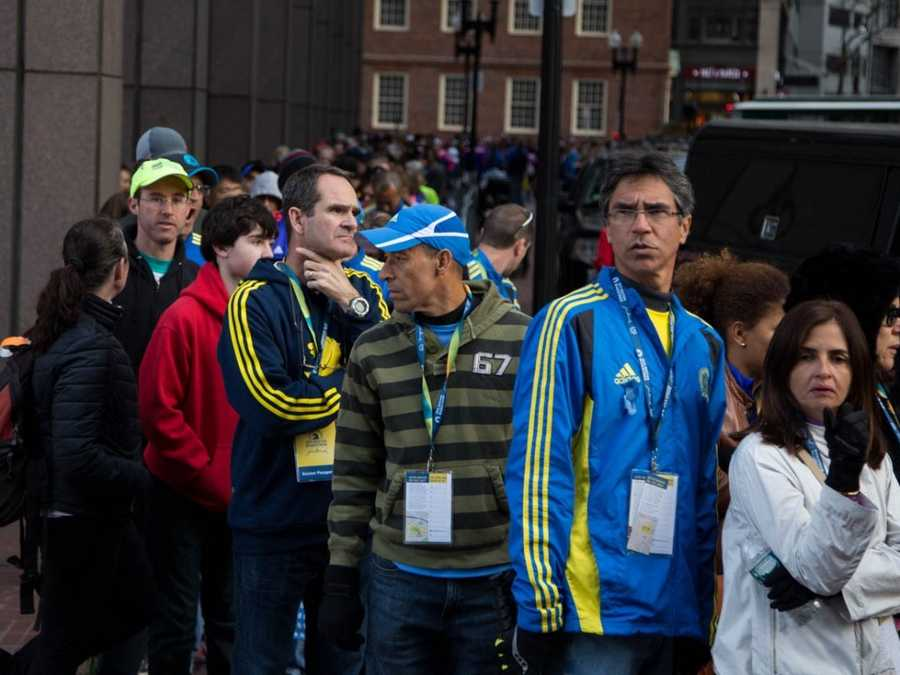 Hundreds of people, including runners, their families and Boston residents waited in line to attend the annual Boston Marathon Pre-Race Dinner.