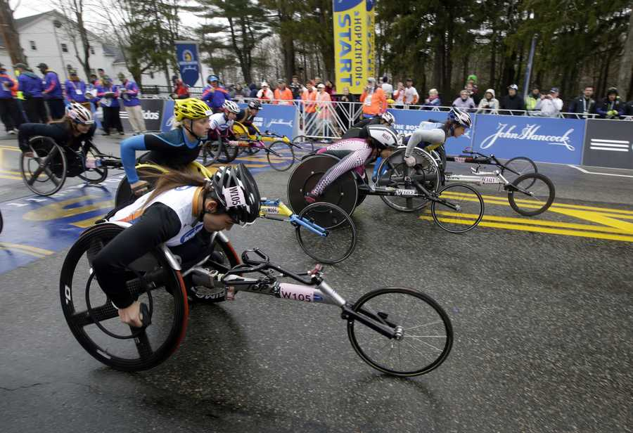 Competitors leave the start line in the women's wheelchair division of the Boston Marathon Monday, April 20, 2015 in Hopkinton, Mass.