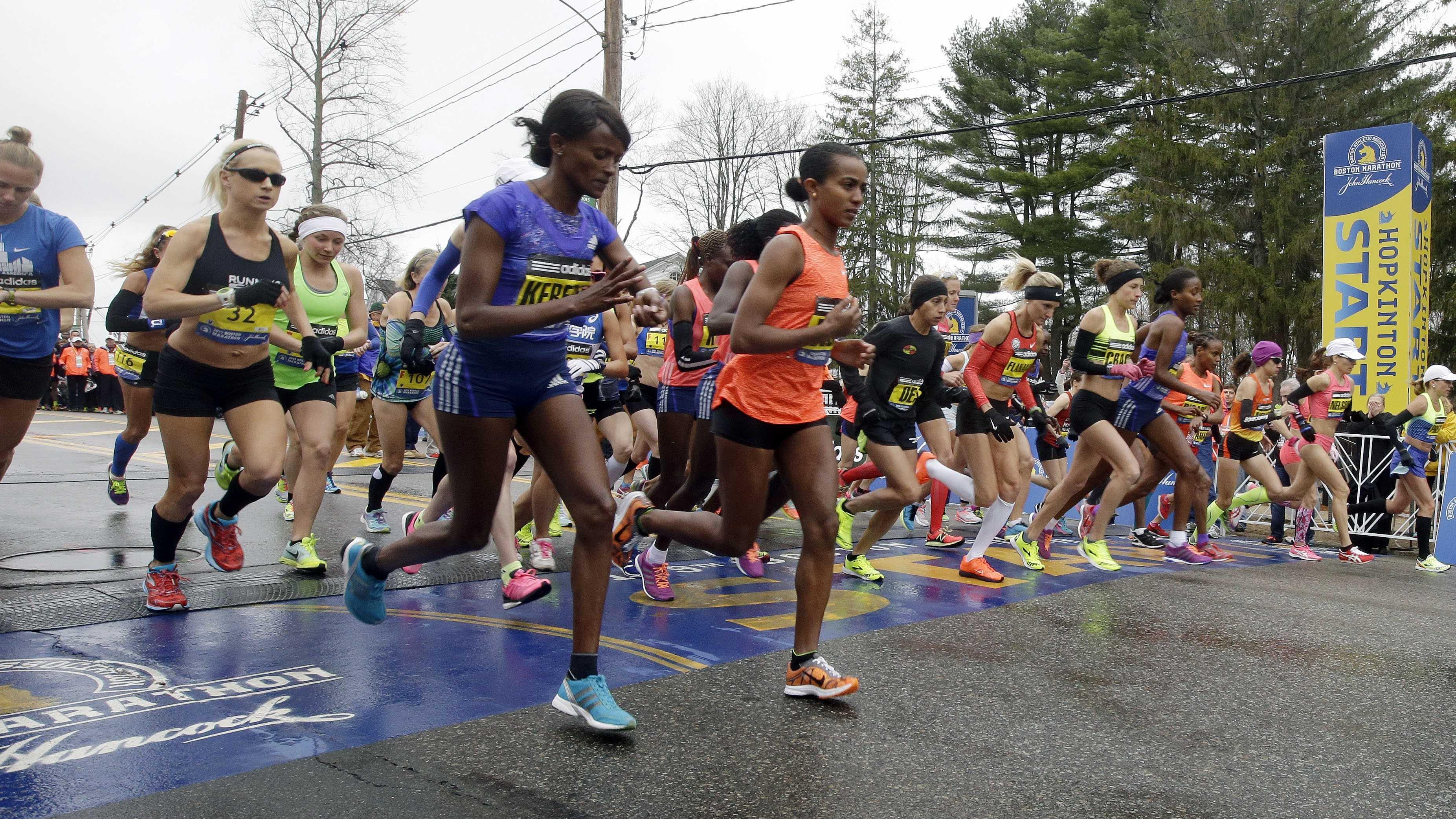 Runners cross the start line in the women's division of Boston Marathon Monday, April 20, 2015 in Hopkinton, Mass.
