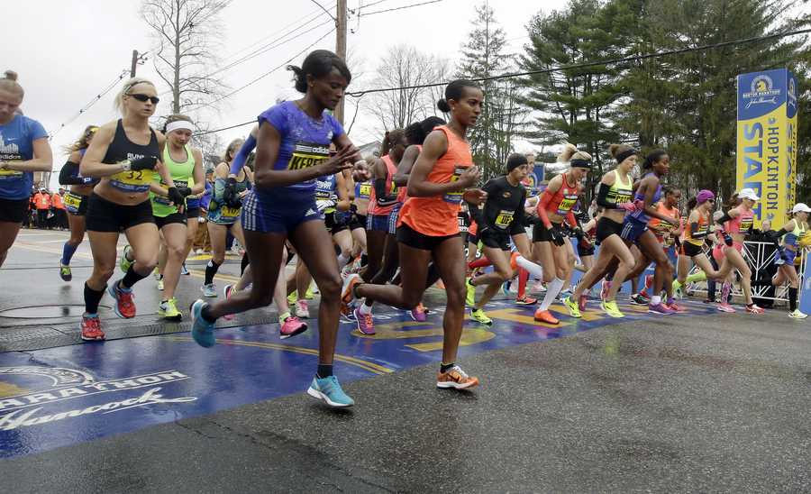 Runners cross the start line in the women's division of Boston Marathon Monday, April 20, 2015 in Hopkinton, Mass.
