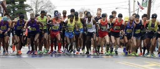 Men's elite runners leave the start line of the Boston Marathon Monday, April 20, 2015 in Hopkinton, Mass.
