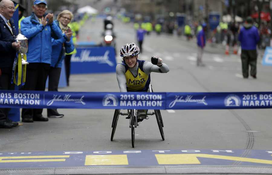 Tatyana McFadden, of America, crosses the finish line to win the women's wheelchair division of the Boston Marathon Monday, April 20, 2015 in Boston.