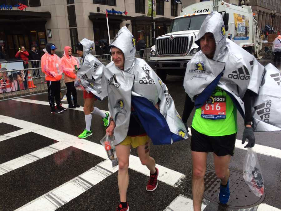 Runners warm up after completing the 2015 Boston Marathon