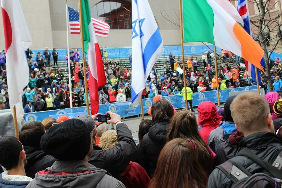 A crowd gathers around the 2015 Boston Marathon Finish Line at Boylston Street to watch the finishers of the 2015 Boston Marathon.