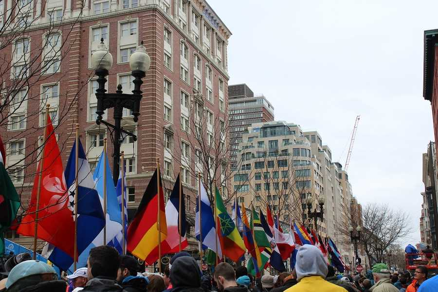 National flags from various countries are present at the 2015 Boston Marathon Finish Line.