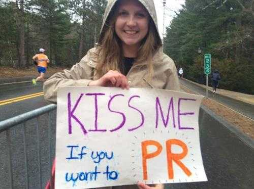 A supporter holds a sign Wellesley College.