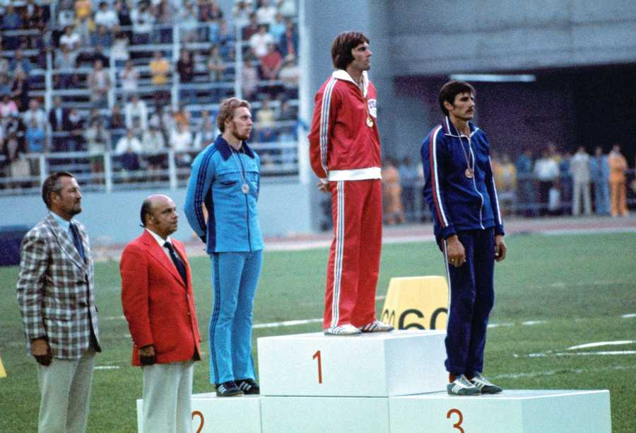 Jenner is shown receiving his medal.