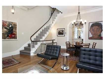 A gracious first floor has soaring ceilings w/ plaster moldings, a front facing living/dining room with views down W Cedar St, oversized windows, reclaimed marble mantle fireplaces, and a luxurious powder room.