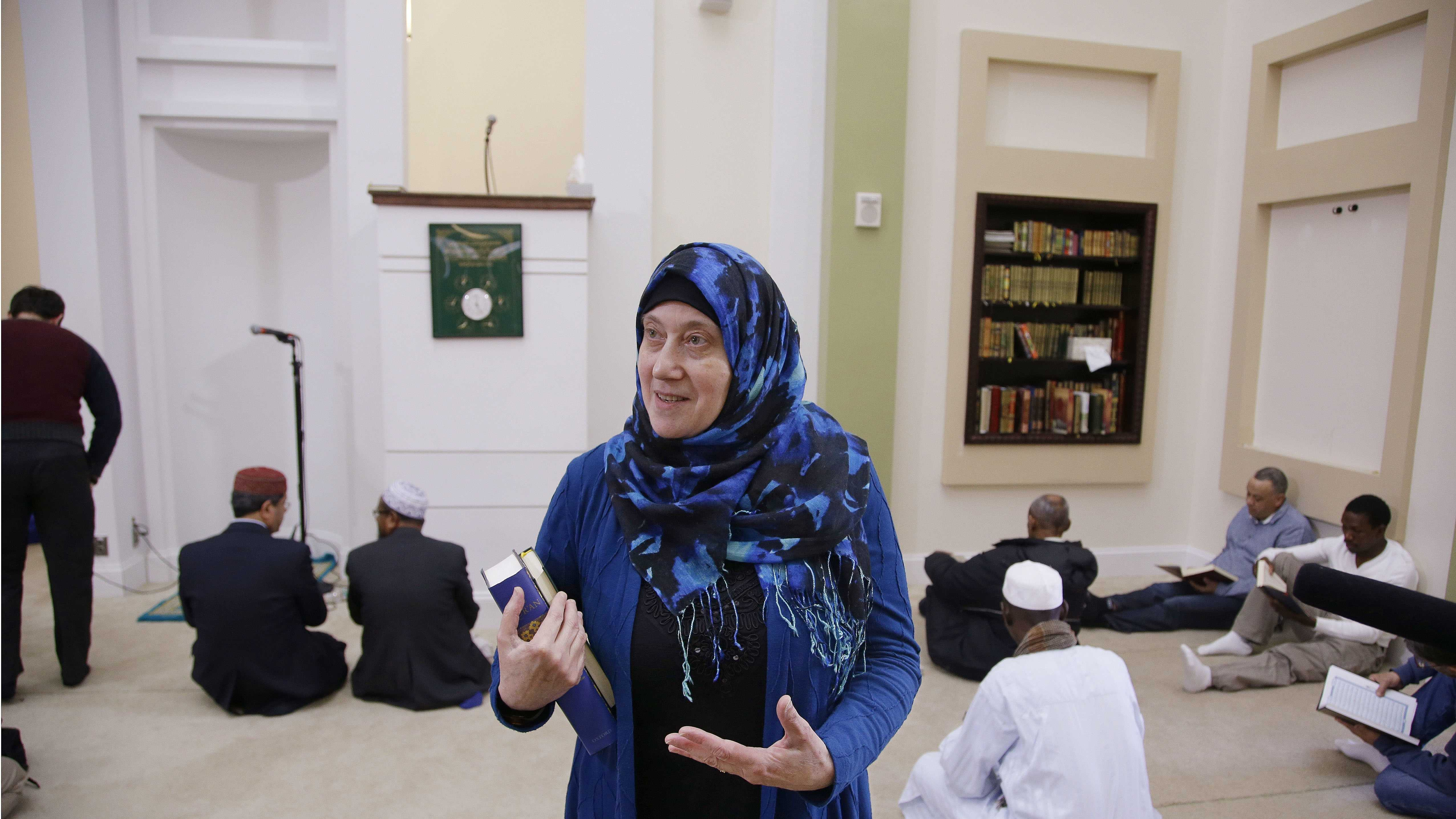 "Barbara Schli conducts a tour of the mosque at the Islamic Society of Boston Cultural Center during an open house themed ""Still Boston Strong"" before ""a call to prayers"" Friday, April 24, 2015, in Boston."