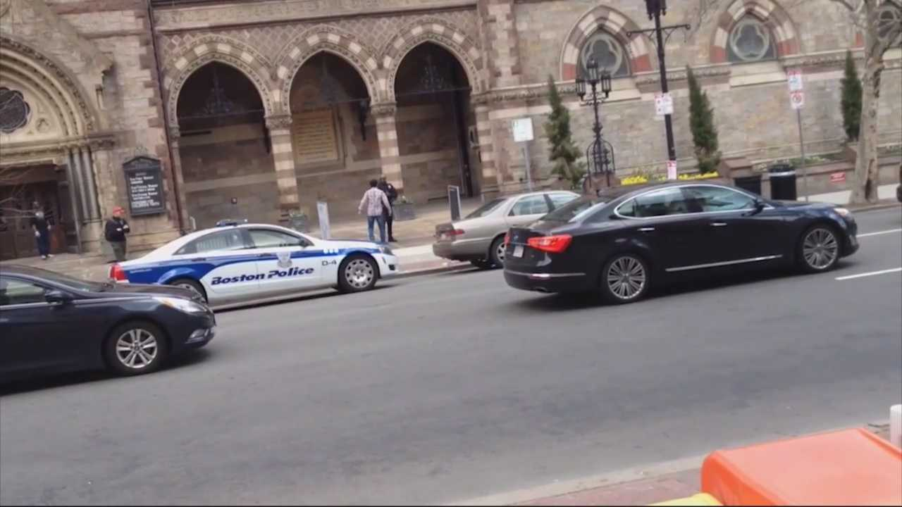 A man was arrested after a confrontation with police prompted a bomb scare at Copley Square on Sunday afternoon.