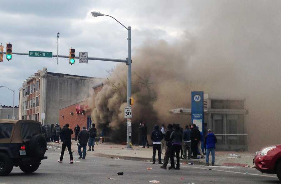 Smoke billows from a CVS Pharmacy store in Baltimore on Monday, April 27, 2015. Demonstrators clashed with police after the funeral of Freddie Gray. Gray died from spinal injuries about a week after he was arrested and transported in a Baltimore Police Department van.