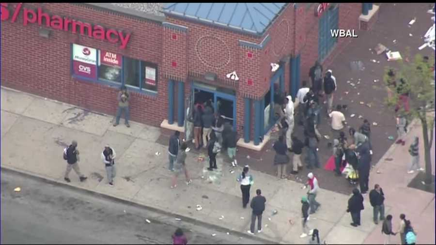 This photo taken from a helicopter shows rioters looting a CVS Pharmacy in Baltimore Monday, April 27, 2015.