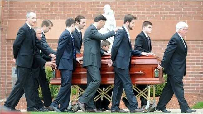 Pallbearer Ryan Quirk, third from right, brother of Jared, has a hand put on his shoulder for support during the funeral Mass for Jared Quirk, 18, of Rockland, on Friday, May 1, 2015 at Holy Family Church in Rockland.