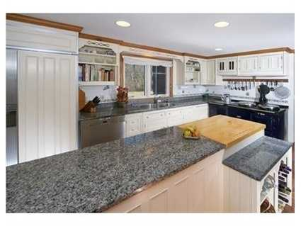 Charmingcountry kitchen w/Aga Stove,Smallbone Cabinetry & delightful breakfast rm w/brick hearth.