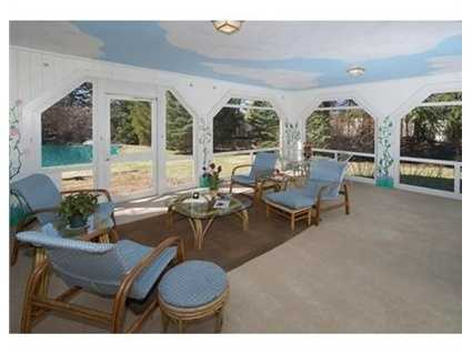 Glass doors open to exquisite gardens,flowering plantings,enchanting brick terrace w/arbor,gorgeous gunite pool,tennis court,2 stall barn,fruit trees, stone walls.